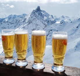 beers in front of alps